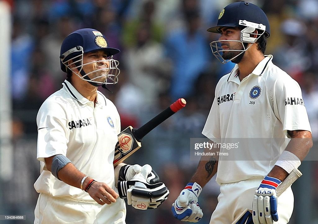 <a gi-track='captionPersonalityLinkClicked' href=/galleries/search?phrase=Sachin+Tendulkar&family=editorial&specificpeople=201846 ng-click='$event.stopPropagation()'>Sachin Tendulkar</a> of India (L) walks past by teammate Virat Kohli after getting out for 94 runs during the fourth day of the third test match between India and West Indies at Wankhede stadium on November 25, 2011 in Mumbai, India. (Photo by Santosh Harhare/Hindustan Times via Getty Images).