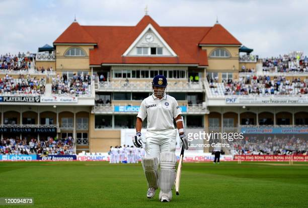 Sachin Tendulkar of India walks to the pavilion after being caught by Andrew Strauss of England off the bowling of Stuart Broad for 16 runs during...