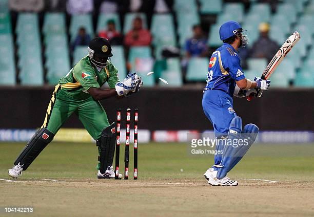 Sachin Tendulkar of Mumbai Indians is stumped by Derwin Christian of Guyana during the Airtel Champions League Twenty20 match between Mumbai Indians...