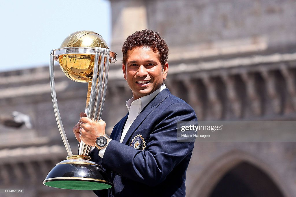 Sachin Tendulkar of the Indian cricket team poses with the ICC Cricket World Cup Trophy, with the Gateway of India in the backdrop, during a photo call at the Taj Palace Hotel on April 3, 2011 in Mumbai, India.