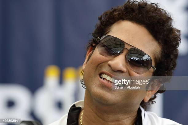 Sachin Tendulkar speaks during a press conference after his masterclass session with young cricketers at the Singapore Cricket Club on June 3 2014 in...