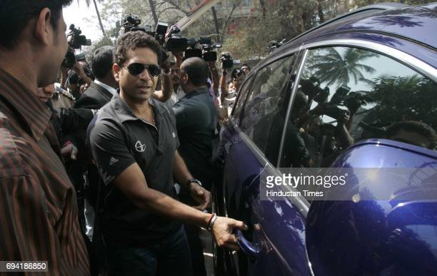 Sachin Tendulkar walks out after meeting BCCI officials to seek clarifications over sponsorship issues for the World Cup and IPL4
