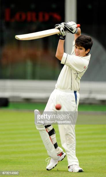 Sachin Tendulkar's son Arjun hits a ball while training with the India team before Thursday's 1st Test match against England at Lord's cricket ground...