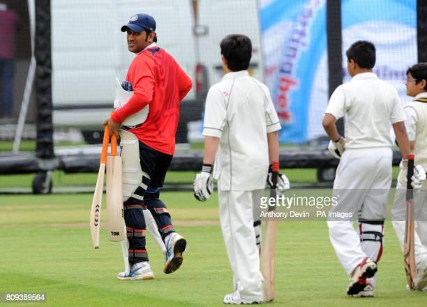 Sachin Tendulkar's son Arjun Tendulkar 9 shares a laugh with India's captain MS Dhoni a practice session at Lord's Cricket Ground London