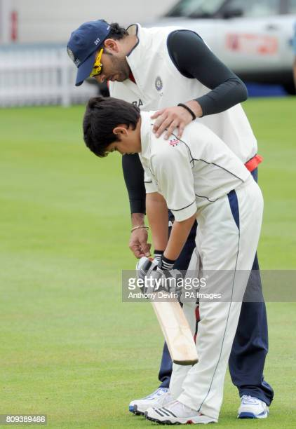 Sachin Tendulkar's son Arjun Tendulkar receives coaching from India's Yuvraj Singh during a practice session at Lord's Cricket Ground London