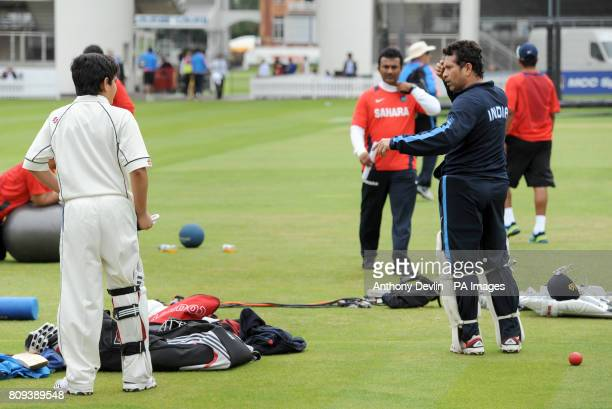 Sachin Tendulkar's speaks with son Arjun Tendulkar 9 during a practice session at Lord's Cricket Ground London