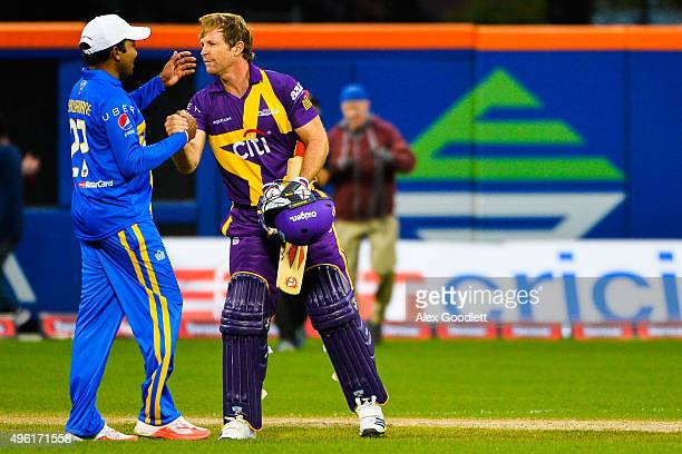Sachin's Blasters player Mahela Jayawardene shakes the hand of Warne's Warriors player Jonty Rhodes after a match in the Cricket AllStars Series at...