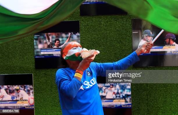 Sachin's' fan waves Indian flag during during the screening of 'Sachin A Billion Dreams' film at PVR on May 24 2017 in Mumbai India British director...