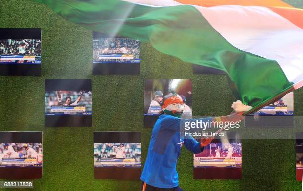 Sachin's' fan waves Indian flag during the screening of 'Sachin A Billion Dreams' film at PVR on May 24 2017 in Mumbai India British director James...