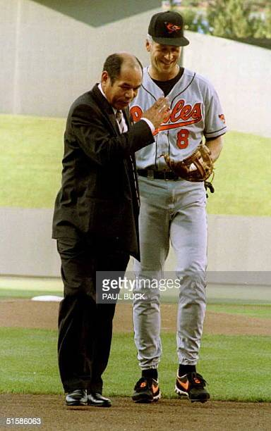 Sachio Kinugasa and Cal Ripken Jr share a laugh following the ceremonial first pitch prior to the Orioles/Royals game at Kauffman Stadium in Kansas...