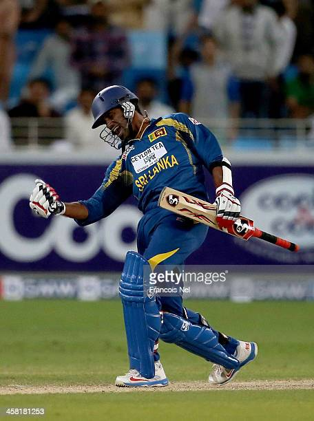 Sachithra Senanayaka of Sri Lanka celebrates after hitting the winning runs to win the second OneDay International match between Sri Lanka and...