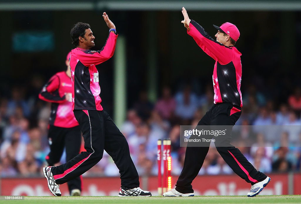 Sachithra Senanayake of the Sixers celebrates with team mates after claiming the wicket of Daniel Harris of the Renegades during the Big Bash League match between the Sydney Sixers and the Melbourne Renegades at SCG on January 9, 2013 in Sydney, Australia.
