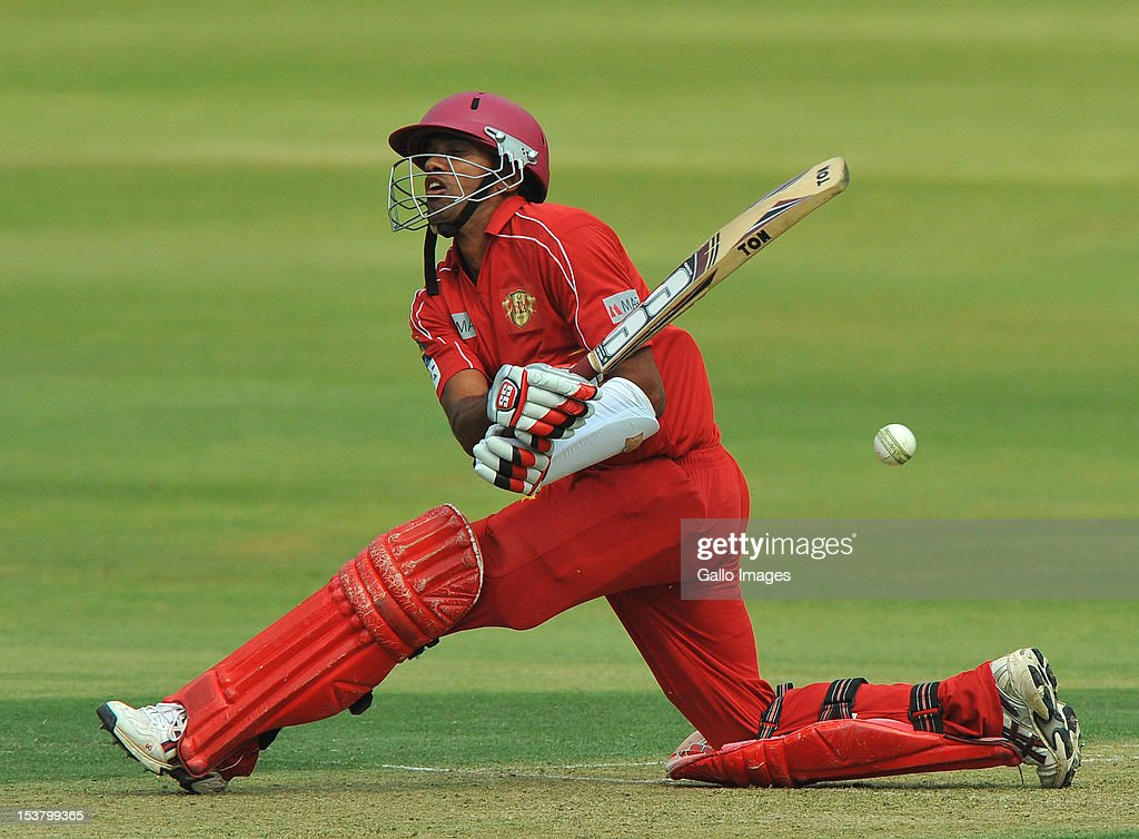 Sachitra Senanayake of Uva sweeps a delivery during the Karbonn Smart CLT20 pre-tournament Qualifying Stage match between Yorkshire (England) and Uva Next (Sri Lanka) at Bidvest Wanderers Stadium on October 09, 2012 in Johannesburg, South Africa.