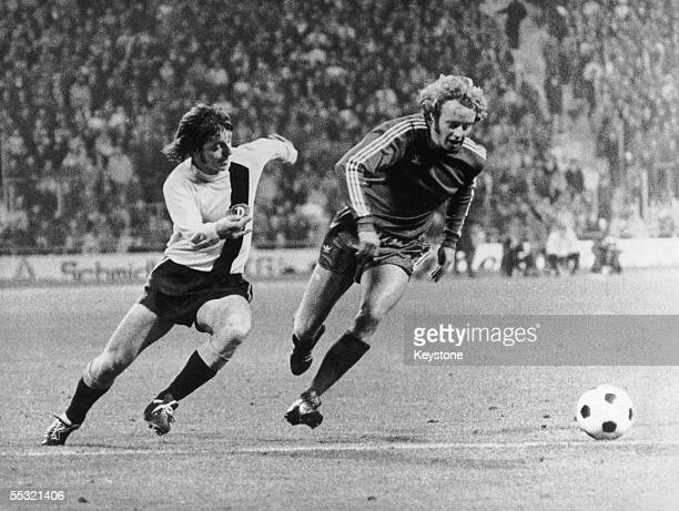 Sachse of Dynamo Dresden in action against Jonny Hansen of Bayern Munich in the second round first leg of the European Cup at the Munich Olympic...