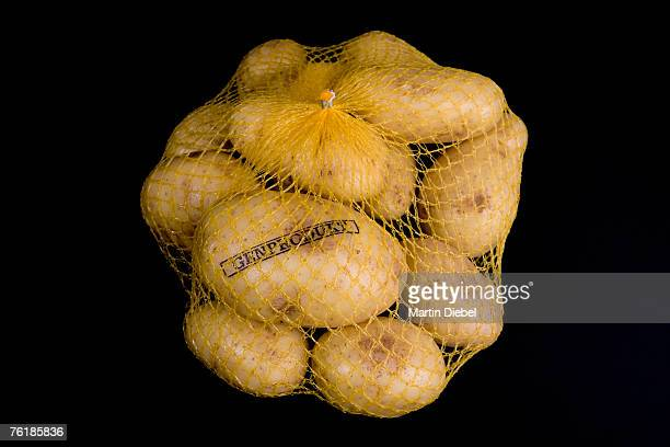 A sack of potatoes stamped 'Genetic Product'