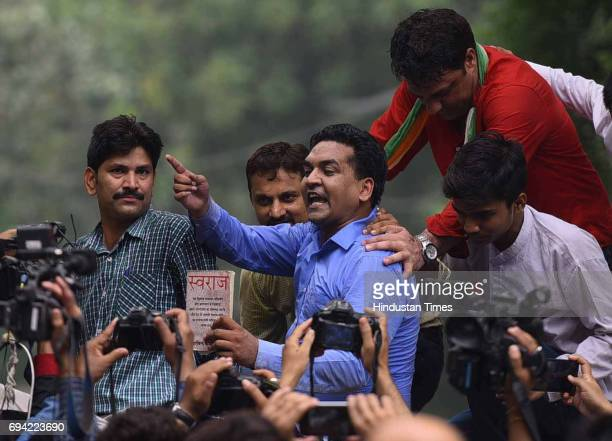 Sacked Delhi Minister Kapil Mishra protests outside residence of Delhi Chief Minister Arvind Kejriwal seeking fresh referendum on June 9 2017 in New...