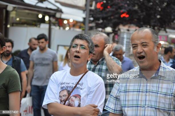 Sacked educator Acun Karadag shouts slogans during a march in support of sacked academic Nuriye Gulmen and primary school teacher Semih Ozakca in...