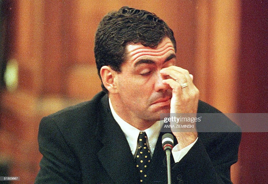 Sacked South African cricket captain Hansie Cronje wipes his eye during his crossexamination at the King Commission of Inquiry into allegations of...