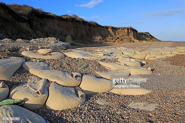 Sacks containing shingle form coastal defenses at Thorpeness Suffolk England UK