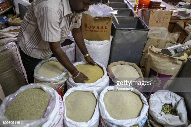 Sacks containing varieties of millet sit on display at a wholesale market in Bengaluru India on Saturday June 10 2017 Millets were a staple in India...