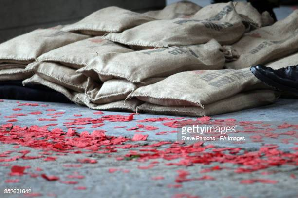 Sacks full of soil from battlefields in Flanders fields which will be loaded onto a gun carriage from the King's Troop Royal Horse Artillery at Menin...