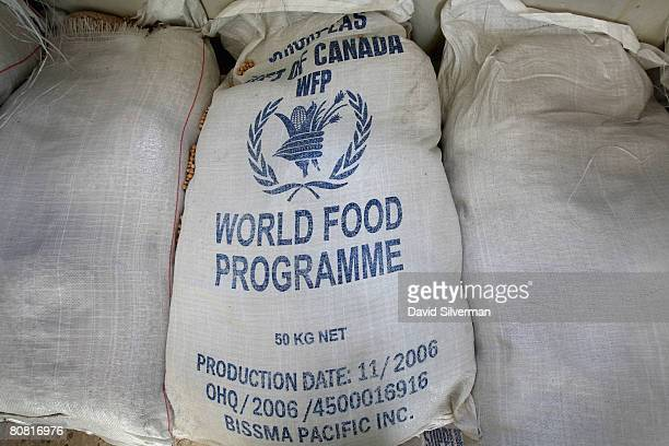 Sacks of donated food wait distribution to Palestinians at a World Food Program warehouse April 21 2008 in the West Bank Palestinian town of Dura The...