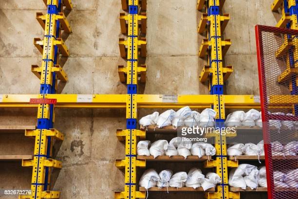 Sacks of gold sit in a storage rack awaiting delivery to the vault at the Rand Refinery Ltd plant in Germiston South Africa on Wednesday Aug 16 2017...