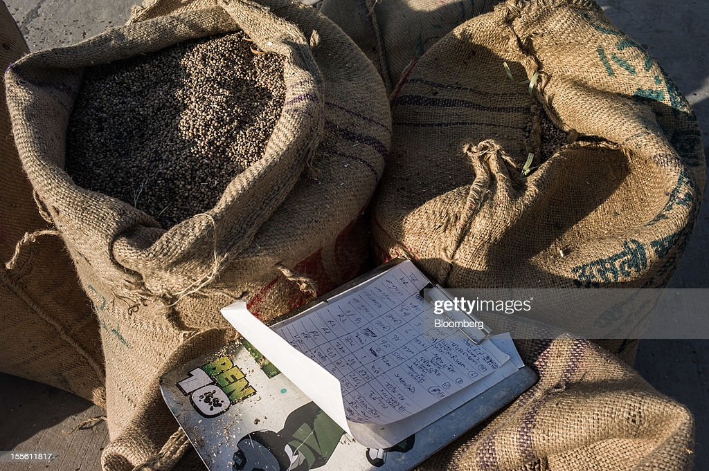 Sacks of guar seed sit at a grain market in Jodhpur, India, on Monday, Oct. 29, 2012. Guar gum is used to blend materials used in fracking. Photographer: Sanjit Das/Bloomberg via Getty Images