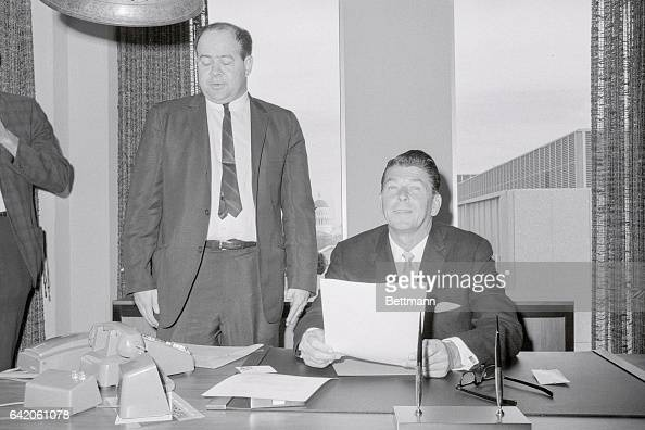 Sacramento California California's Governorelect Ronald Reagan confers with Press Secretary Lyn Nofziger at his desk in the IBM building on Capitol...