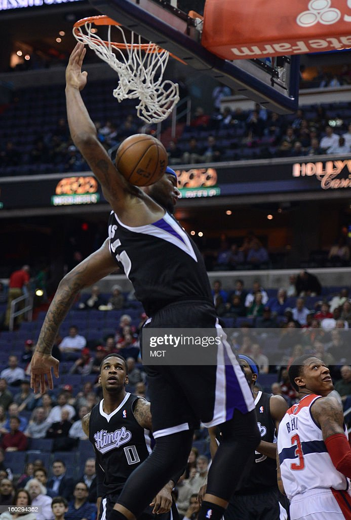 Sacramento Kings center DeMarcus Cousins (15) finishes off a dunk against the Washington Wizards in the first quarter at the Verizon Center in Washington, D.C., Monday, January 28, 2013.