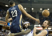 Sacramento Kings center DeMarcus Cousins is fouled as he goes to the basket against New Orleans Pelicans power forward Anthony Davis and power...