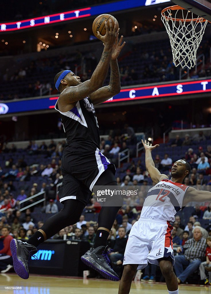 Sacramento Kings center DeMarcus Cousins (15). left. takes the ball up for a score past Washington Wizards point guard A.J. Price (12) in the first quarter at the Verizon Center in Washington, D.C., Monday, January 28, 2013.