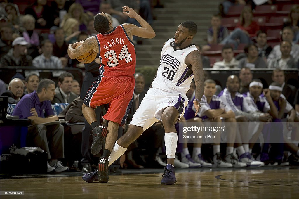 Sacramento Kings' Donte Green (20) is called for a blocking foul on New Jersey Nets' Devin Harris in the third quarter at Arco Arena in Sacramento, California, on Friday, November 19, 2010. The Kings slipped past the Nets, 86-81.