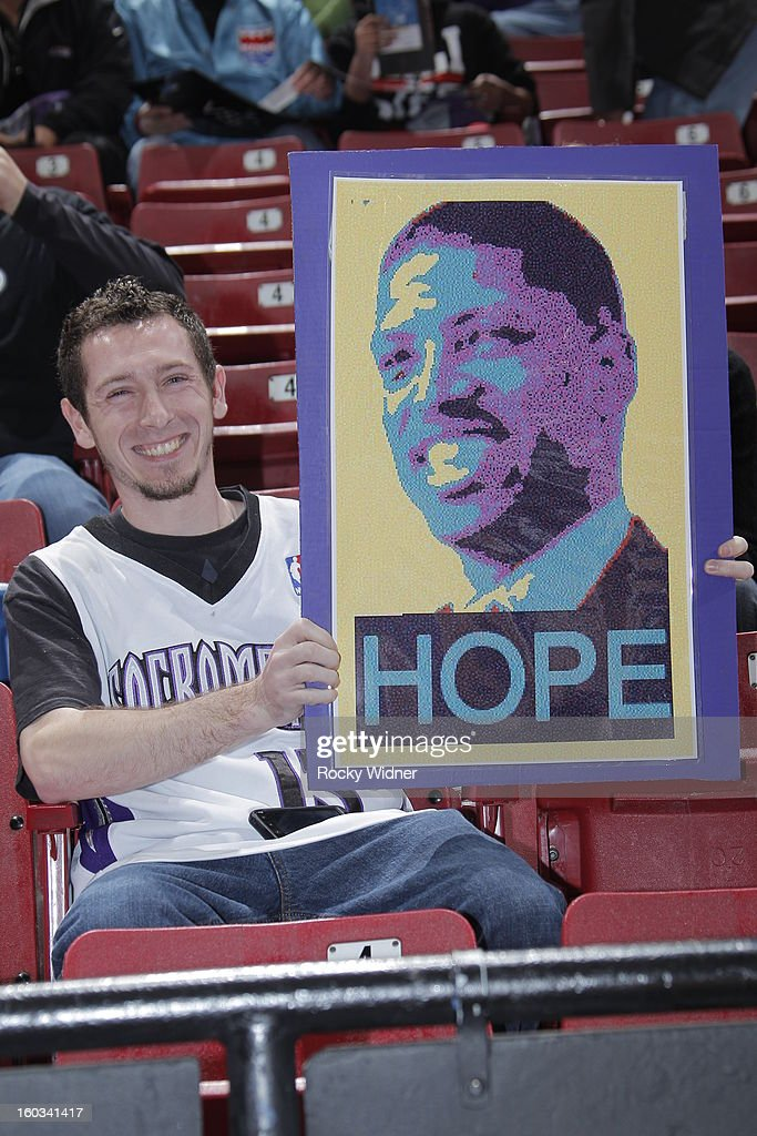 A Sacramento Kings fan holds up a poster of Sacramento Mayor Kevin Johnson in a game against the Oklahoma City Thunder in Sacramento on January 25, 2013 at Sleep Train Arena in Sacramento, California.