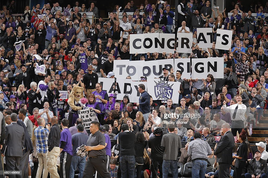Sacramento Kings fans cheer on Barbara Rust affectionately known as 'The Sign Lady' on her induction into the ESPN Fan Hall of Fame during the game...