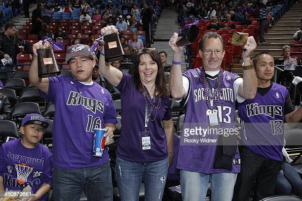 Sacramento Kings fans hold up cowbells prior to the game against the Detroit Pistons on November 15 2013 at Sleep Train Arena in Sacramento...