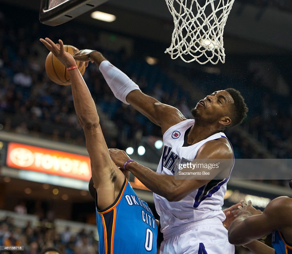 Sacramento Kings forward Jason Thompson blocks the shot attempted by Oklahoma City Thunder guard Russell Westbrook during the first quarter on...
