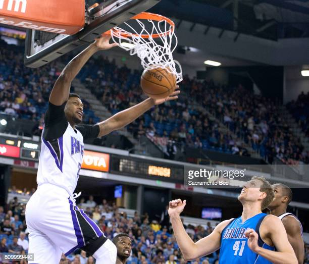 Sacramento Kings forward Rudy Gay dunks while Dallas Mavericks forward Dirk Nowitzki watches on March 27 at Sleep Train Arena in Sacramento Calif