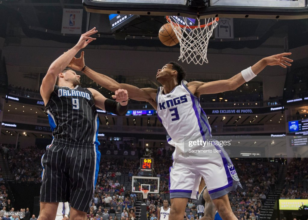Sacramento Kings forward Skal Labissiere (3) defends the basket against Orlando Magic center Nikola Vucevic (9) on Monday, March 13, 2017 at Golden 1 Center in Sacramento, Calif.