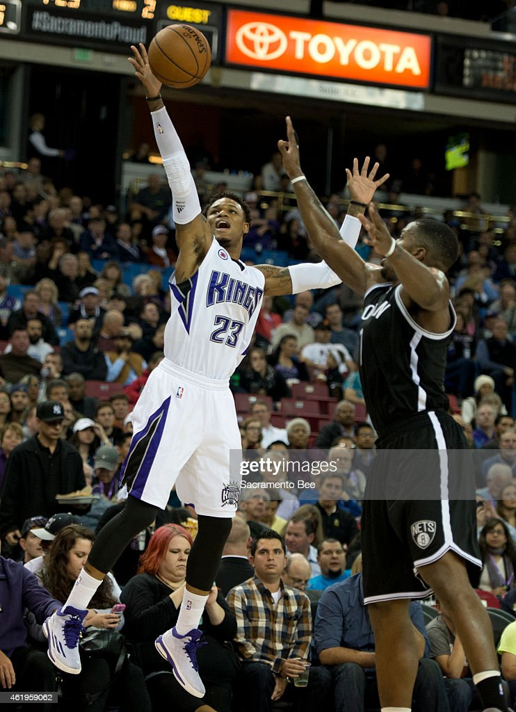 Sacramento Kings guard <a gi-track='captionPersonalityLinkClicked' href=/galleries/search?phrase=Ben+McLemore&family=editorial&specificpeople=9966388 ng-click='$event.stopPropagation()'>Ben McLemore</a> (23) loses control of the ball as he tries to launch a three point shot with Brooklyn Nets forward <a gi-track='captionPersonalityLinkClicked' href=/galleries/search?phrase=Joe+Johnson+-+Basketball+Player&family=editorial&specificpeople=201652 ng-click='$event.stopPropagation()'>Joe Johnson</a> (7) defending during the second quarter on Wednesday, Jan. 21, 2015, at Sleep Train Arena in Sacramento, Calif.