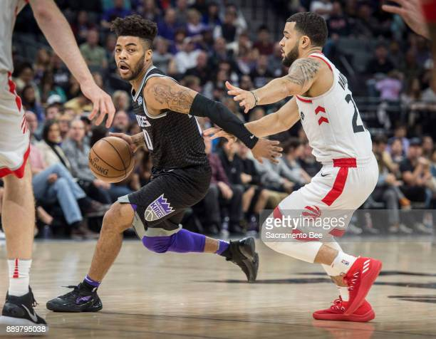 Sacramento Kings guard Frank Mason III drives to the basket against Toronto Raptors guard Fred VanVleet on Sunday Dec 10 2017 at the Golden 1 Center...