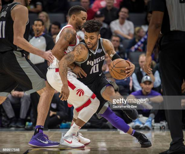 Sacramento Kings guard Frank Mason III is defended by Toronto Raptors forward Norman Powell on Sunday Dec 10 2017 at the Golden 1 Center in...