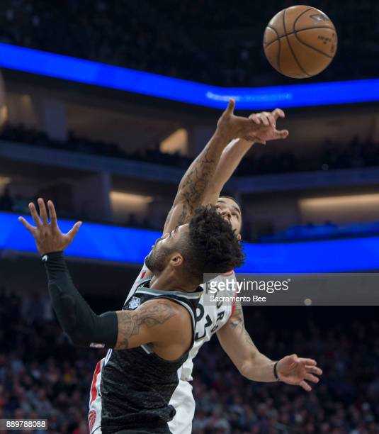 Sacramento Kings guard Frank Mason III is fouled as he goes to the basket against Toronto Raptors guard Fred VanVleet on Sunday Dec 10 2017 at the...