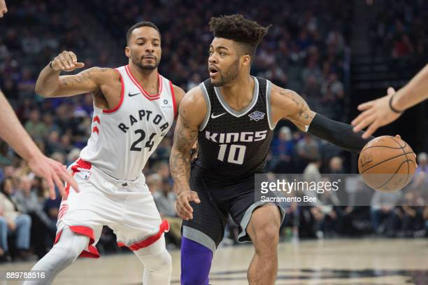 Sacramento Kings guard Frank Mason III looks to make a pass against Toronto Raptors forward Norman Powell on Sunday Dec 10 2017 at the Golden 1...