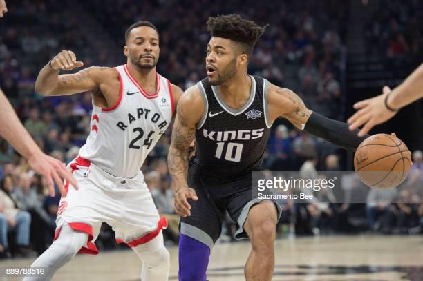 Sacramento Kings guard Frank Mason III looks to make a pass against Toronto Raptors forward Norman Powell on Sunday Dec 10 2017 at the Golden 1...