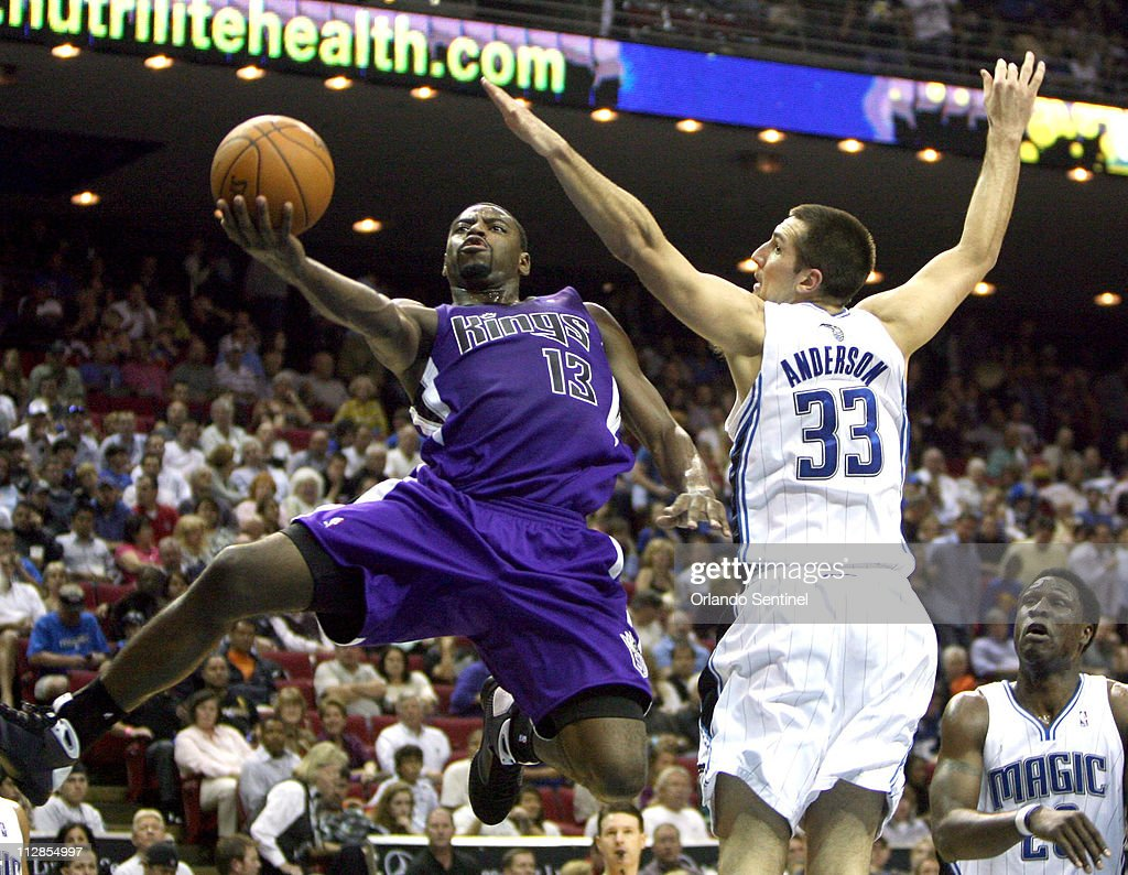 Sacramento Kings guard Tyreke Evans (left) puts up a shot around the defense of the Orlando Magic's Ryan Anderson in NBA action at Amway Arena in Orlando, Florida, on Friday, January 22, 2010. Orlando won, 100-84.