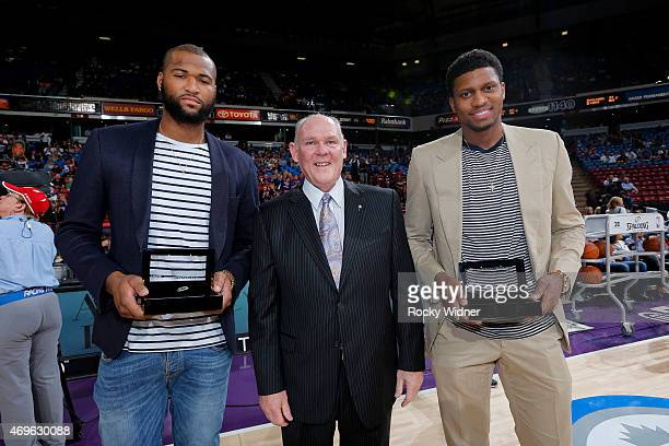 Sacramento Kings head coach George Karl presents Rudy Gay and DeMarcus Cousins of the Sacramento Kings their USA Championship rings prior to the game...
