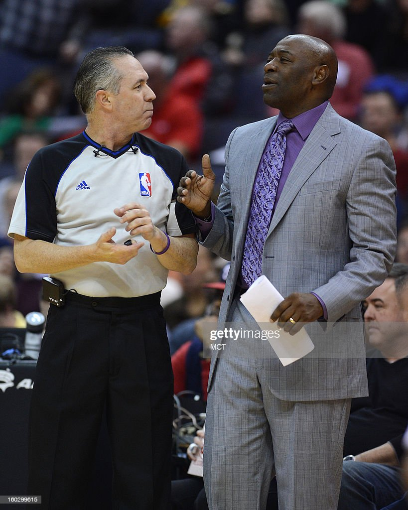 Sacramento Kings head coach Keith Smart, right, has a word with referee referee Jason Phillips (23) in the second quarter against the Washington Wizards at the Verizon Center in Washington, D.C., Monday, January 28, 2013. The Kings defeated the Wizards, 96-94.