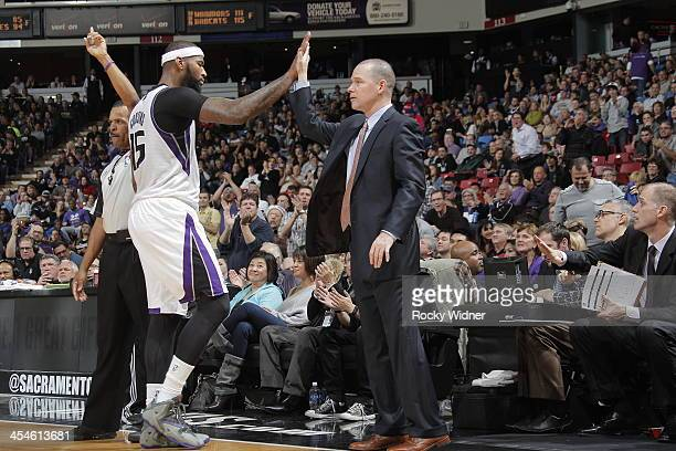 Sacramento Kings head coach Michael Malone and DeMarcus Cousins high five following the defeat of the Dallas Mavericks at Sleep Train Arena on...