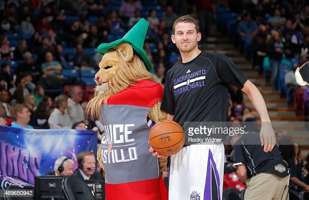 Sacramento Kings mascot Slamson dressed as a bottle of Sauce Castillo alongside of Nik Stauskas during the game against the Utah Jazz on April 5 2015...